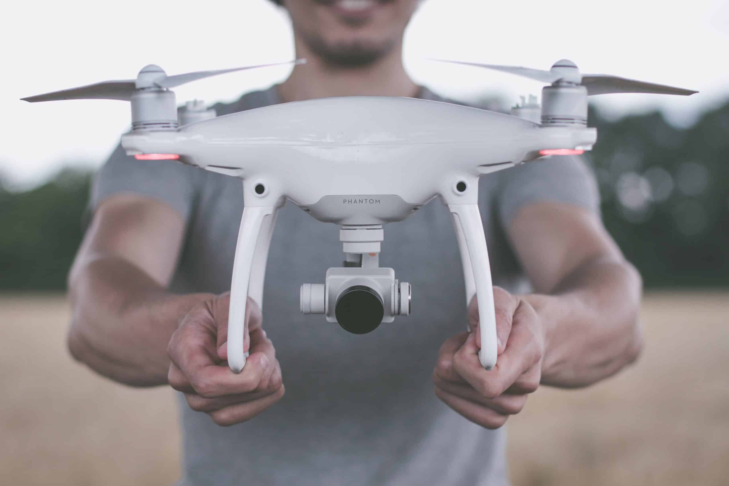 Holding a drone preparing for drone photography and videography